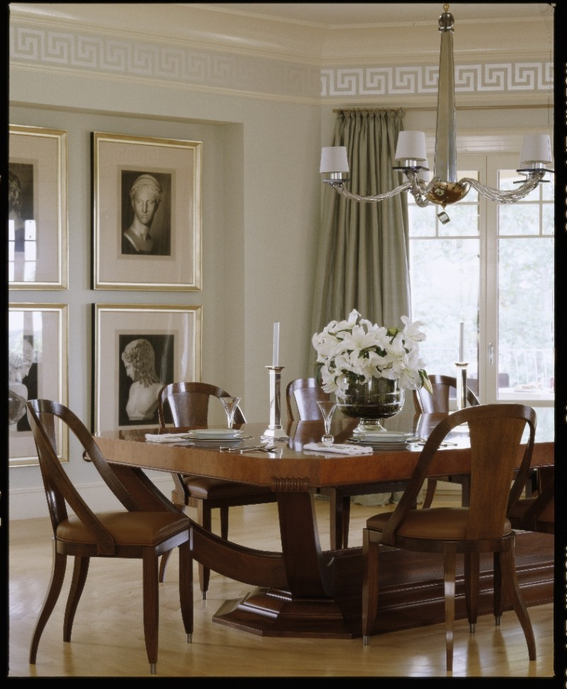 The Emile Ruhlmann-inspired mahogany dining table. Photography by Michael Partenio. © Meredith Corporation.