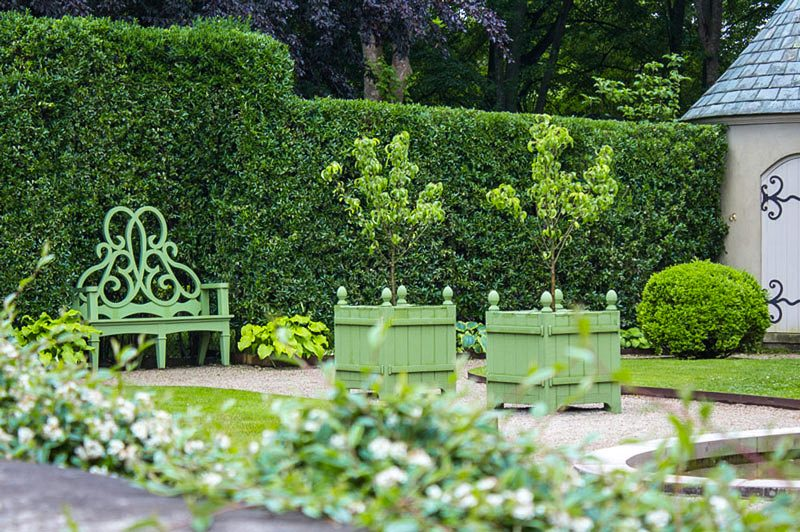 In The Same Winter Garden Low Evergreen Hedges Of Korean Boxwood And Cotoneaster Form A Stepped Up Design That Is Separated From Next Room By