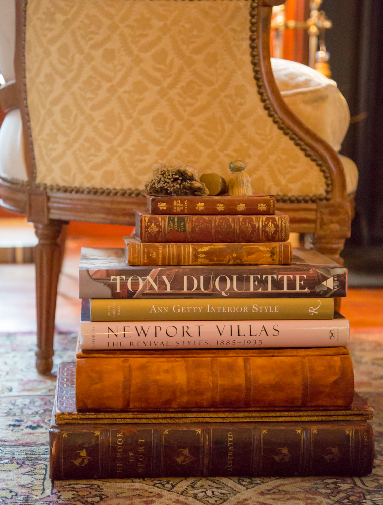 "Stack large, substantial books to create a side table. Keep in mind…they aren't called ""coffee table books"" for nothing!"