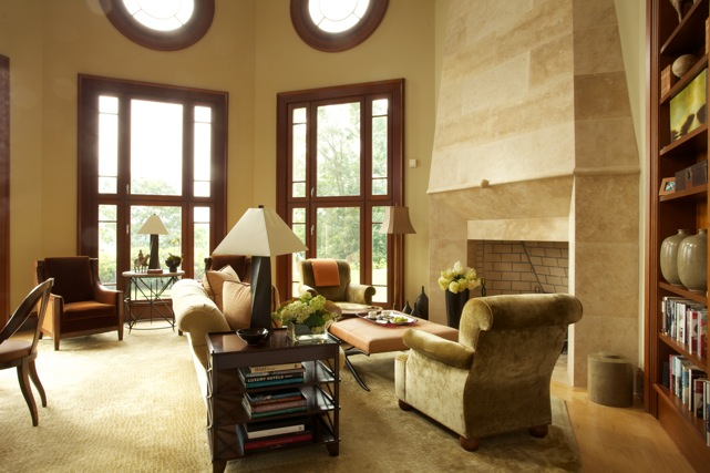 Full blocks of limestone create the impressively tall fireplace in the 600 sq.' octagonal-shaped library.